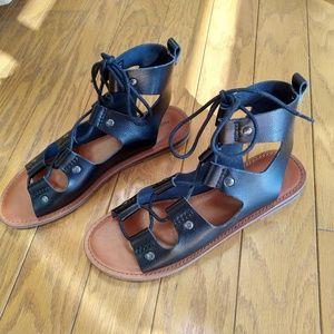 Like-new gladiator sandals -- vegan leather